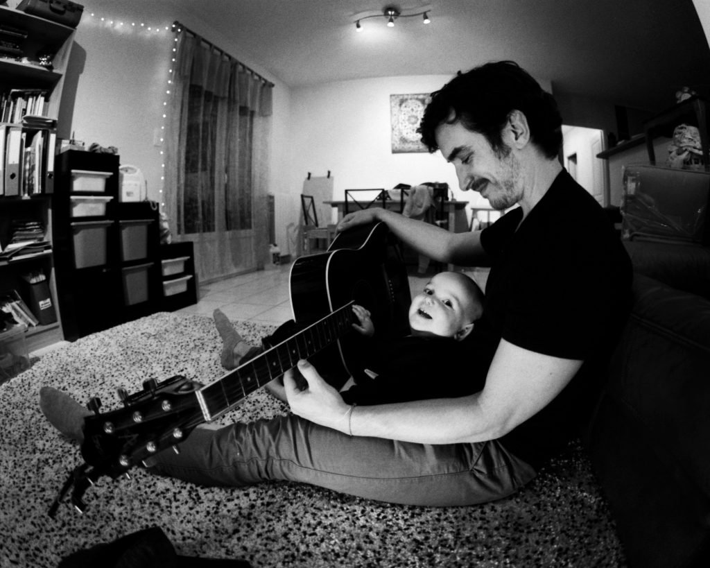 David playing guitar with his son